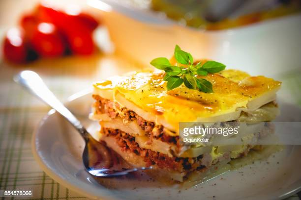 Slice of freshly cooked Serbian moussaka meal on white plate