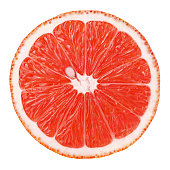 Top view of textured ripe slice of pink grapefruit citrus fruit isolated on white background with clipping path