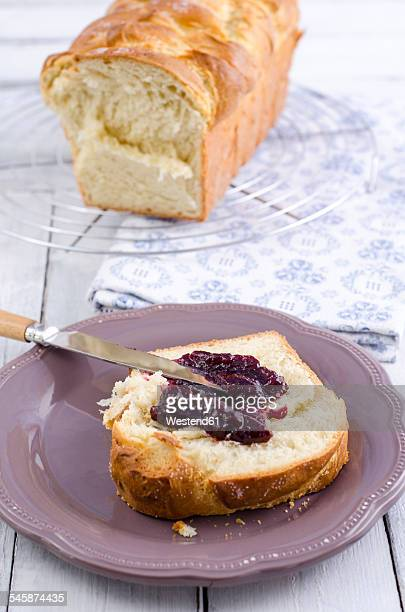 Slice of home-baked brioche spread with wild berry jam