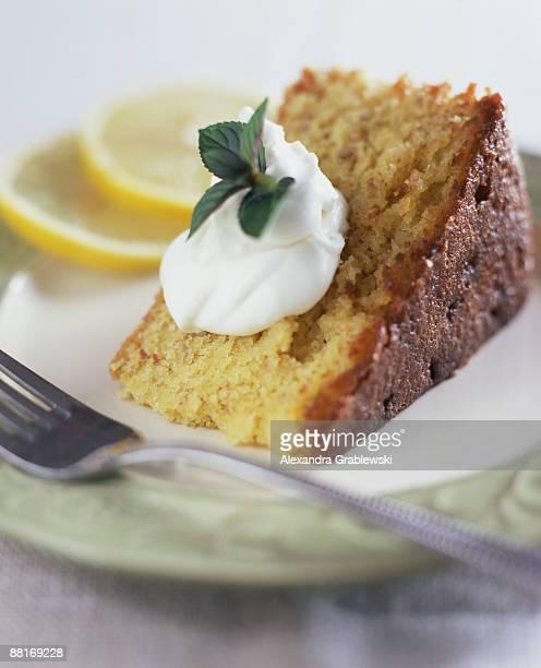 Slice of lemon cake with whipped cream