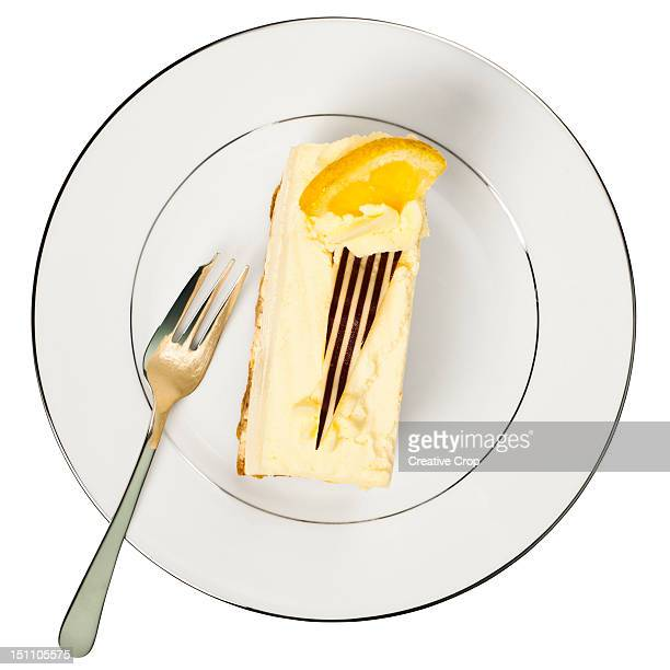 Slice of lemon cheese cake on a white plate