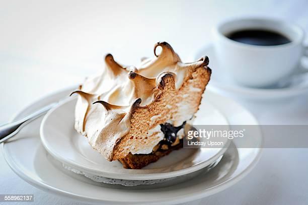 Slice of meringue pie with chocolate on restaurant table