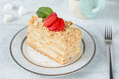 Napoleon cake or Mille Feuille, russian cuisine layered cake with pastry cream. Close up view