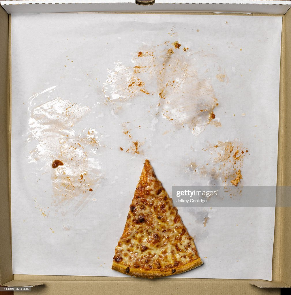 Slice of pizza in box, overhead view : Stock Photo