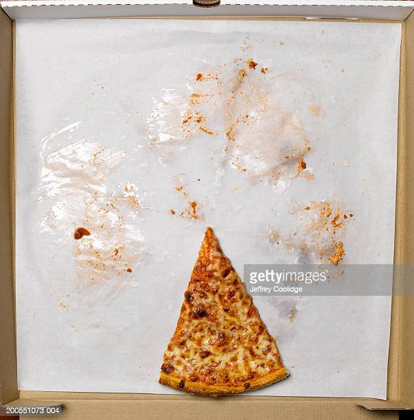 Slice of pizza in box, overhead view