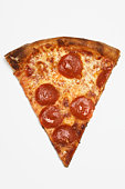Slice of pizza, white background, overhead view