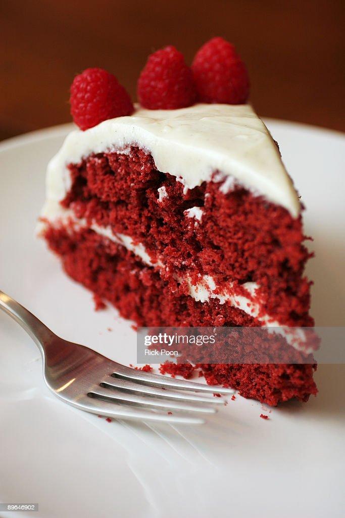 Slice of red velvet cake with raspberries : Stock Photo