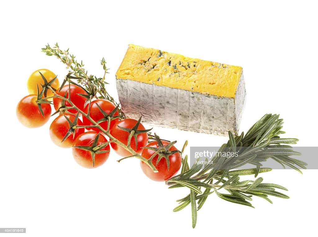 Slice of Roquefort cheese with tomato and herbs : Stock Photo