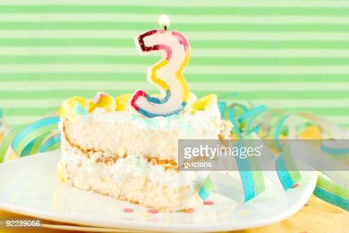 slice of third birthday cake : Stock Photo