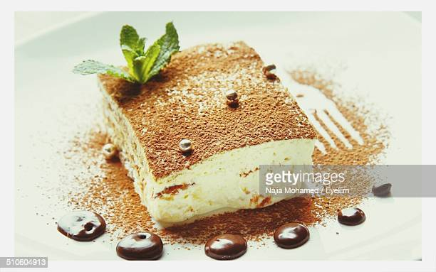 Slice of tiramisu cake served on plate