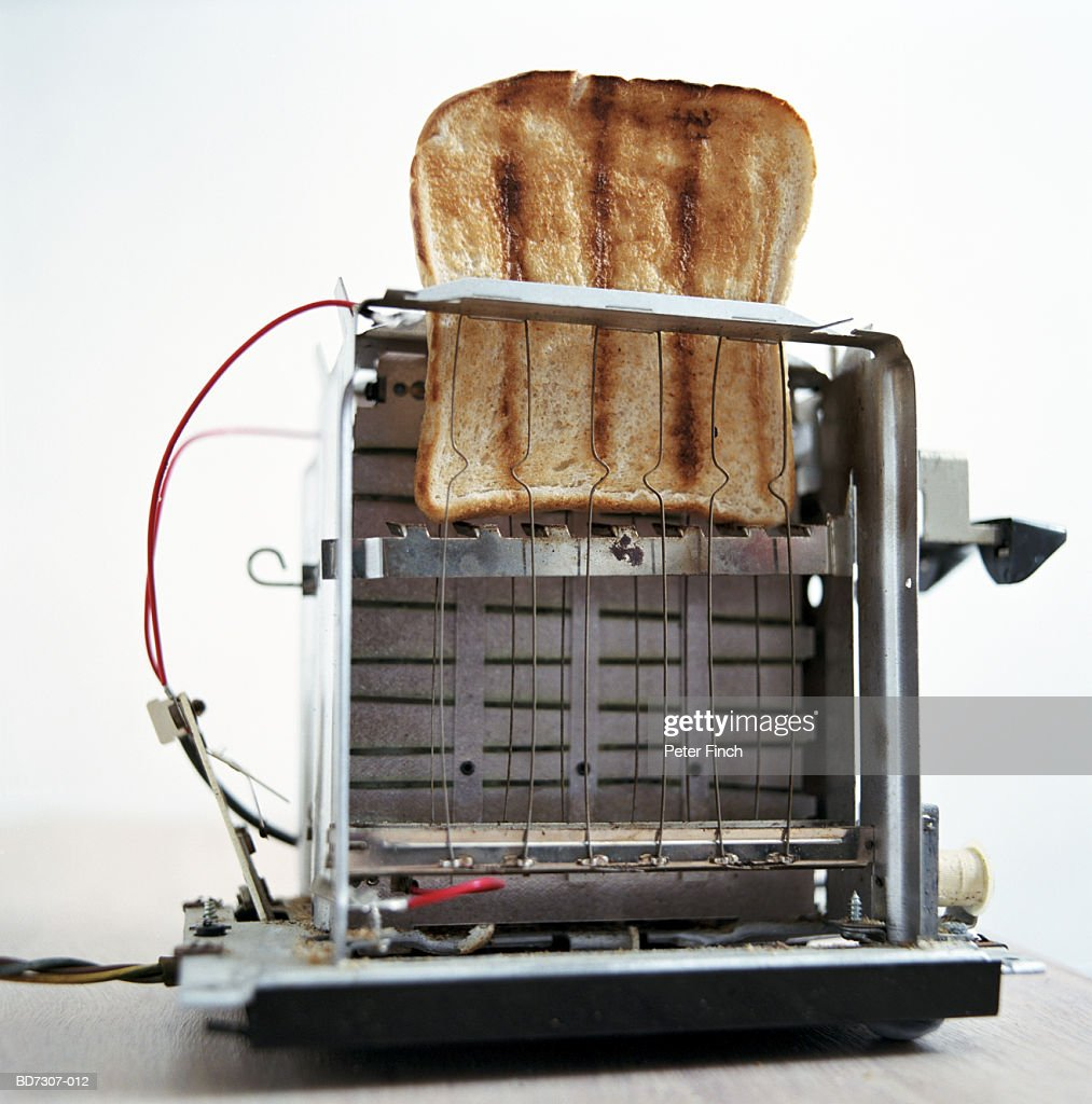 Inside Of A Toaster ~ Slice of toast inside stripped down toaster closeup stock