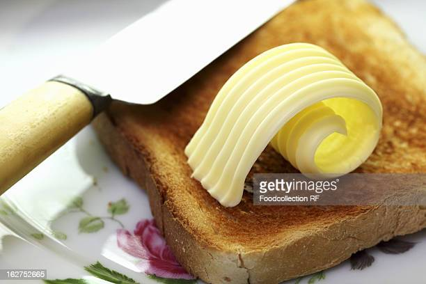 Slice of toast with curl of butter