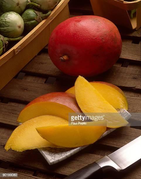 Sliced and whole mango