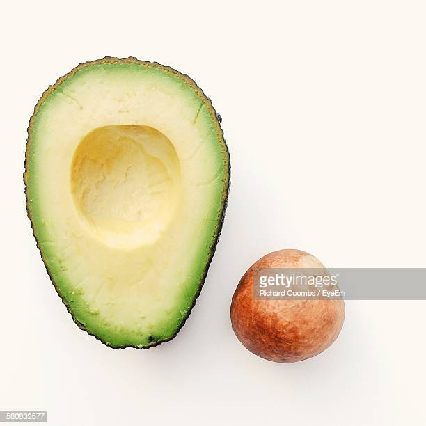 Sliced Avocado And Seed Against White Background