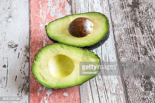 Sliced avocado on wood