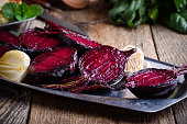Sliced baked beetroot on rustic outdoor party table, diet and  healthy eating food concept