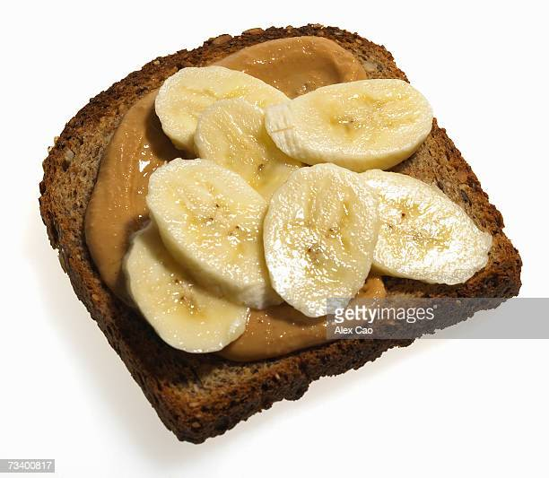 Sliced banana and peanut butter on slice of grain toast