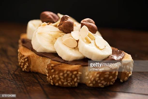 Sliced banana, chocolate spread on toast