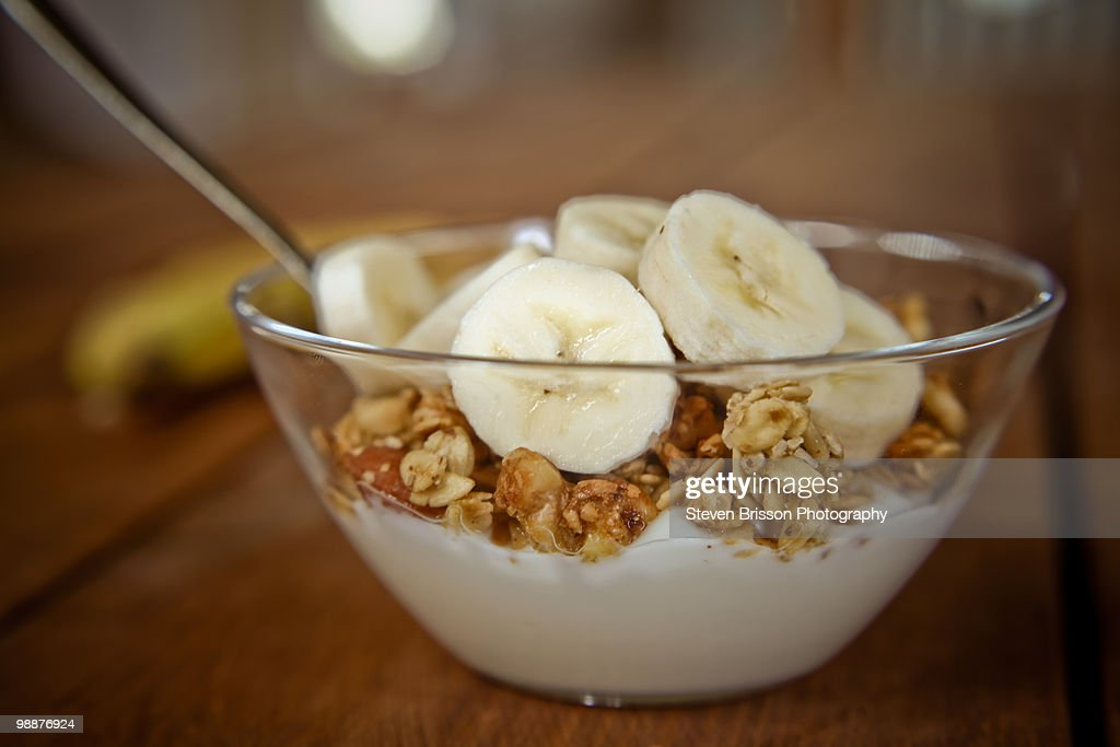 Sliced bananas, granola and yogurt in dish : Stock Photo