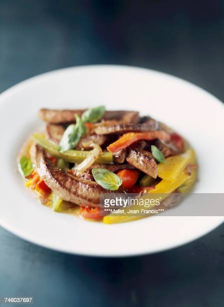 Sliced beef with peppers and basil