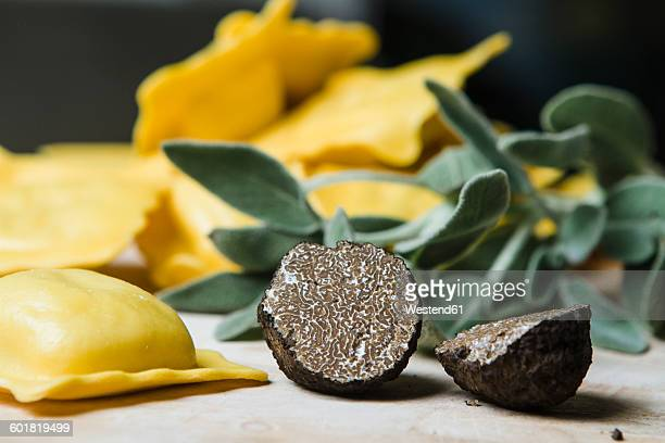 Sliced black truffle, sage and homemade ravioli filled with black truffle and sage