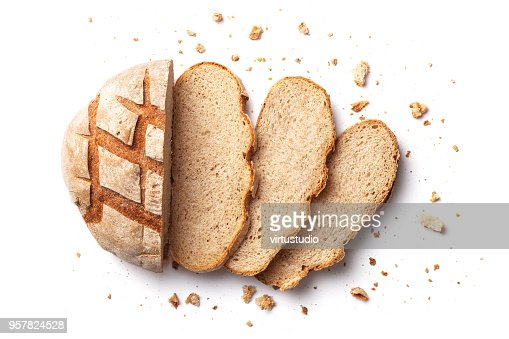 Sliced bread isolated on a white background. Bread slices and crumbs viewed from above. Top view : Foto de stock