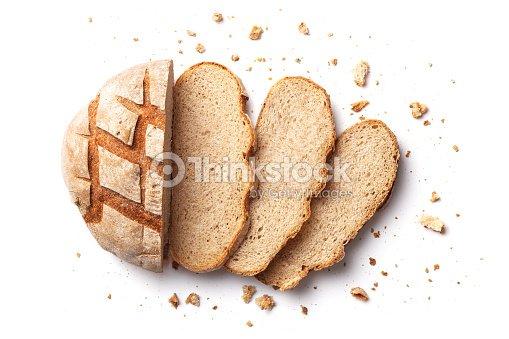 スライスされたパンは、白い背景で隔離。パンのスライスとパンくずは、上から見た。トップ ビュー : ストックフォト