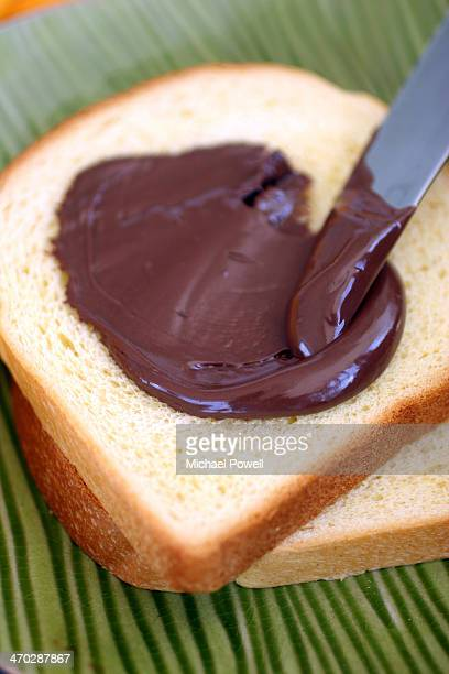 Sliced bread with chocolate spread.