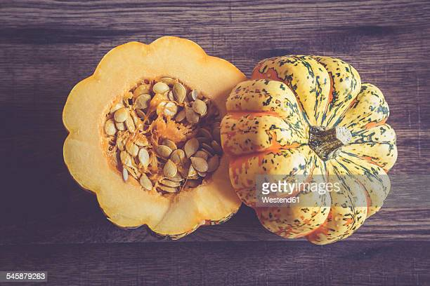 Sliced chameleon pumpkin on dark wood