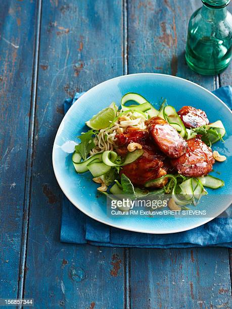 Sliced chicken with cucumbers and herbs