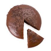 Sliced chocolate fudge cake isolated on white background