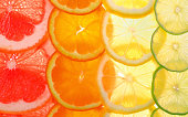 Sliced citrus fruits background (grapefruit, orange, lemon, lime)