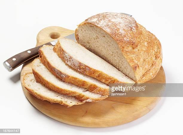Sliced fresh bread on a wooden cutting board