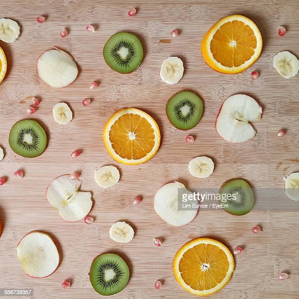 Sliced Fruits On Wooden Table