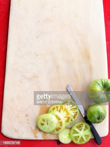 Sliced green tomatoes on board