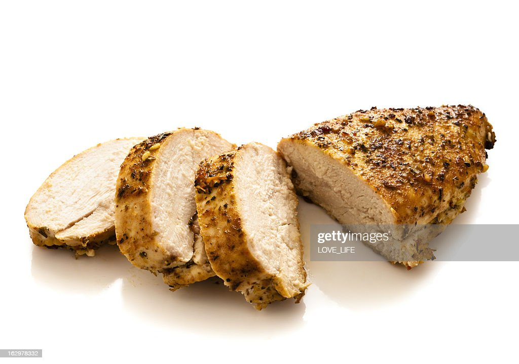 Sliced grilled and seasoned chicken breast : Stock Photo
