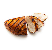 A sliced grilled chicken breast on a white background