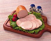 Sliced ham on lettuce, high angle view