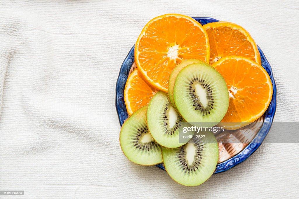 sliced Kiwi fruit, citrus Orange towel : Stock Photo