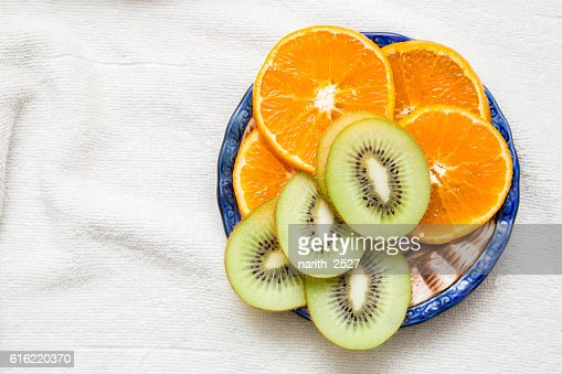 sliced Kiwi fruit, citrus Orange towel : Stock Photo
