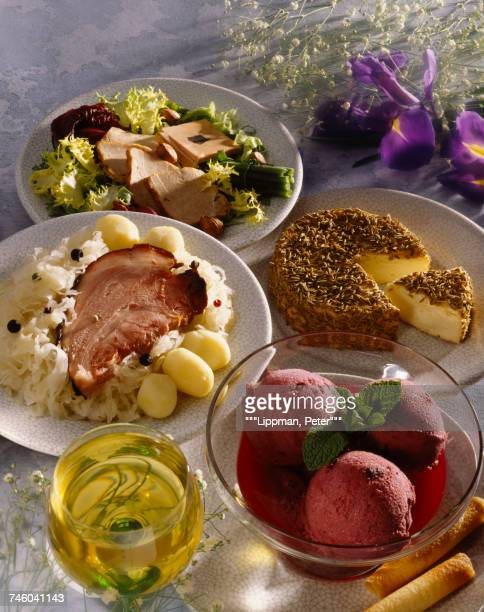 Sliced knuckle of ham with sauerkraute,cumin Munster,blueberry sorbet