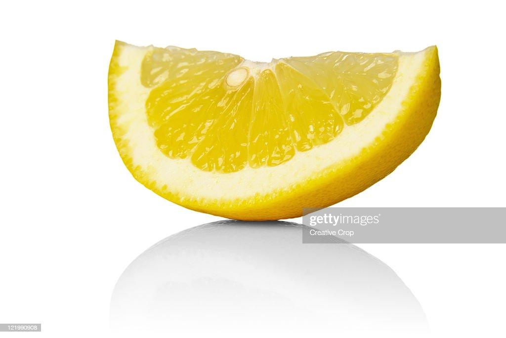 Sliced lemon wedge : Stock Photo