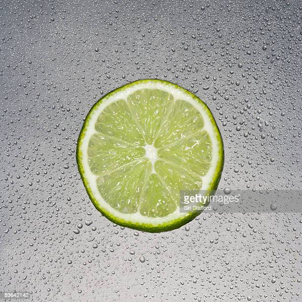 sliced lime surrounded by  water-beads
