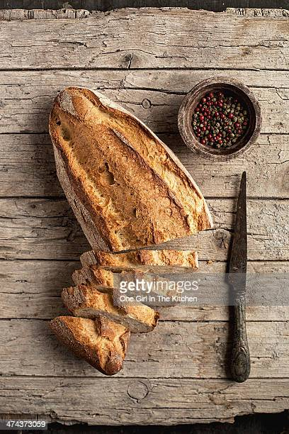 Sliced Loaf of Italian Bread with Knife