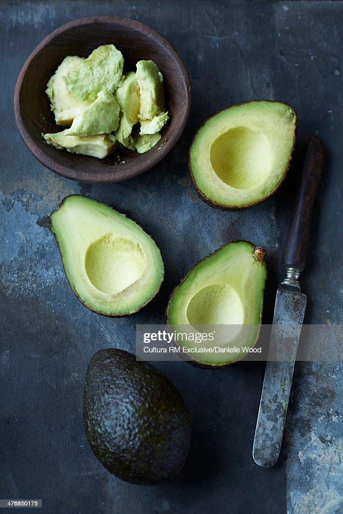 Sliced, mashed and whole avocado