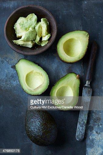 Sliced, mashed and whole avocado : Stock Photo