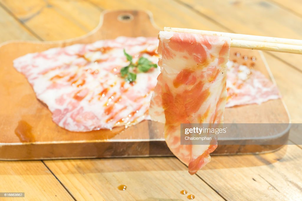Sliced meat and chopsticks : Stock Photo
