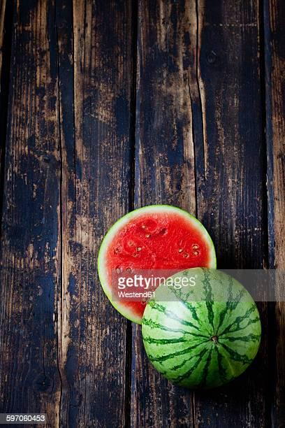 Sliced mini watermelon on dark wood