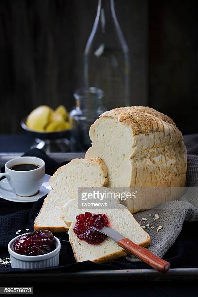 Sliced oatmeal bread loaf on moody background
