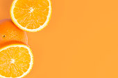 Sliced Orange On Orange Background